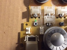 put in switches in the cleaned wholes, they should sit plain and tight on circuit board